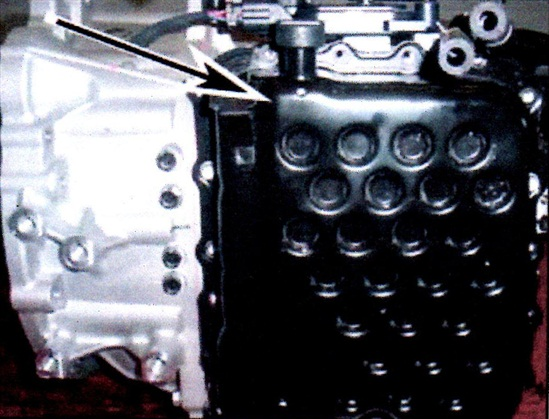 Remove the valve body cover by removing the bolts and tapping with a rubber hammer.