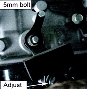 Insert a 5mm bolt to align the select lever. Note the location of the alignment bolt and the adjuster.