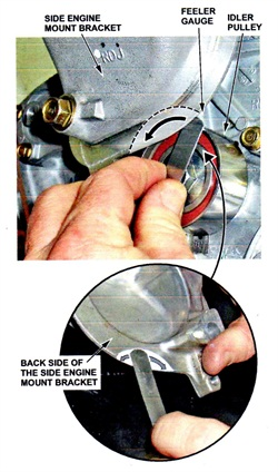 Insert a 0.95 mm feeler gauge between the top edge of the timing belt idler pulley and the back side of the engine mount bracket to check for clearance.