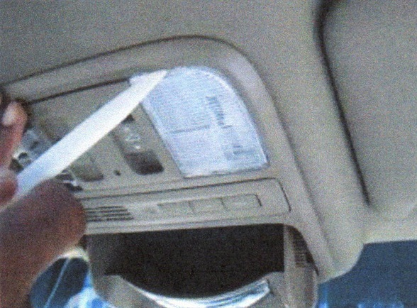 Use a trim tool to remove the map light lenses from the overhead console.