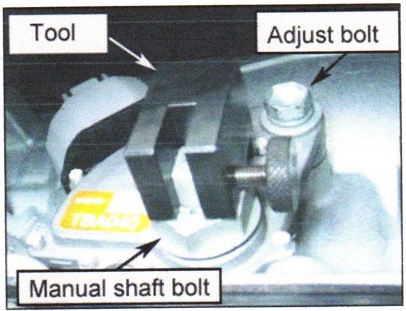 The adjustment tool installs over the manual shaft bolt.