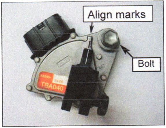 Rotate the neutral start switch to align the marks on the tool and the switch.
