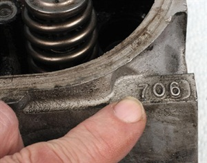 Cylinder heads that are identified with the number 706 are potentially plagued with porosity and cracking problems. A good direct replacement head is number 862.