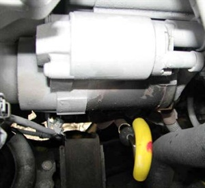 The ATF dipstick is located next to the starter.
