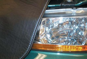 Avoid placing fender covers over headlight lenses on DRL-equipped vehicles.