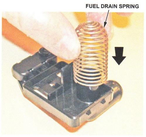 Install the fuel drain spring onto the EVAP vent hose port.
