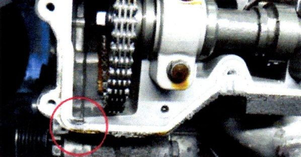 Note the location where the timing chain cover meets the cylinder head. Both spots require the specified RTV sealant prior to installing the new gasket and the cylinder head cover.