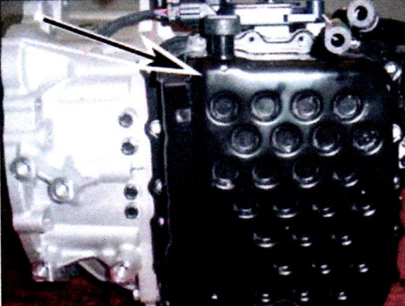 After removing the valve body cover bolts, tap with a rubber hammer to dislodge the cover.