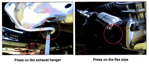 With the engine running and the transmission in reverse (with parking brake on), use a long screwdriver to pry against the two locations shown here. If the noise stops, the front muffler must be replaced.