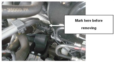 Place a reference mark as shown before removal. Once the new holder is installed, it will be difficult to relocate to the original location.