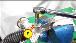 Remove the yoke plug (E).