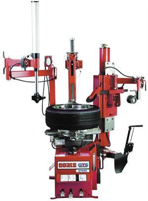 The Coats GTS-90 tiltback tire changer's powered roller disk helps with bead loosening, bottom bead removal and top bead mounting. It also assists with tire pressure monitoring system access. It services tires from 6 to 24 inches in diameter. Photo courtesy of Hennessy Industries Inc.