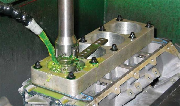 If you plan to use cylinder head studs, do so from the very start of the machining procedures. Here a set of studs (the same studs that will be used during assembly) are used to secure the deck plate during cylinder honing.