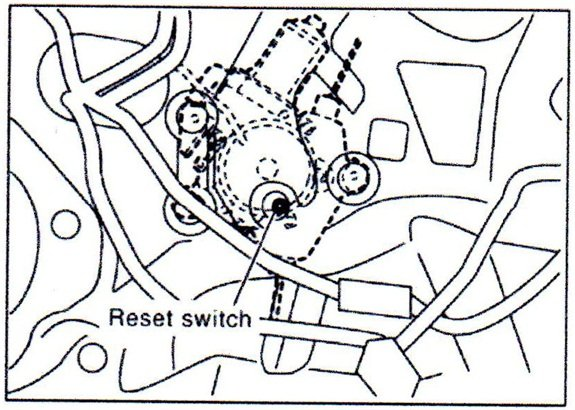 Note the location of the power window motor reset switch.