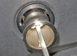 With both ends of the tool engaged, pull the socket straight out.