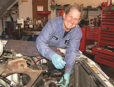 """Owner and Master Tech Judy Mayne offers vehicle service """"with a woman's touch,"""" garnering close relationships with a loyal customer base."""