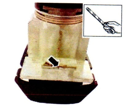 Using a file, deburr/remove the split line from the door lock cylinder.