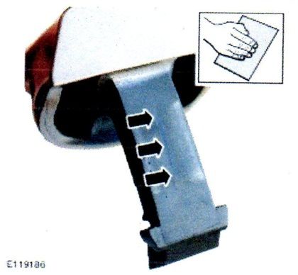 Using 800-grit paper, remove the split line from the center of the door handle strap, and from both rear edges of the strap.