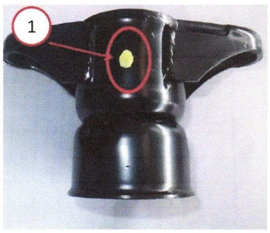 The replacement upper shock mount should feature a yellow dot.