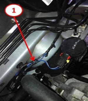 Create a slight bend in the harness and wrap electrical tape to secure the bend.
