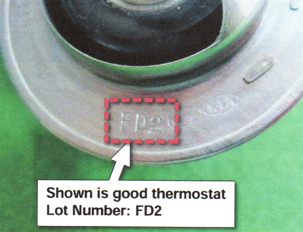 The example shown here shows thermostat lot number FD2, which does not require replacement.