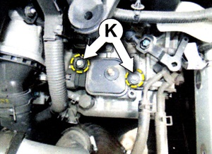Remove and discard the 2 original inhibitor switch mounting bolts.