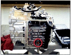 After removing the valve body cover, locate the transaxle temperature sensor (see red circle).