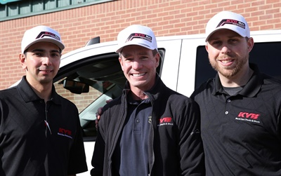 (left to right): Sal Fabela, KYB territory sales manager; Mike Davis, winner of the KYB Max Truck and owner of Carrollton Complete Automotive; and Chris Gillund, KYB marketing manager.