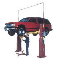 Raise the vehicle slightly above the desired work height, then slowly lower to allow the arms to rest on their locking blocks. Never rely on the hydraulic system alone. If a hydraulic failure occurs, even a short drop onto the locks can unsettle the vehicle.