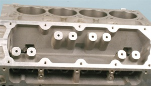 As this example of a bare LS block shows, there's no access to the lifters at the top valley. The lifters are located in the upper deck areas of the block and are held captive by the cylinder head. When removing or installing a cam, there's no need to remove the heads either.