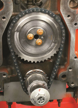 This view shows the timing setup (with pulley, water pump, front cover and oil pump removed). Depending on the version of the oil pump drive gear, this might incorporate the crank gear or it may be a separate gear.