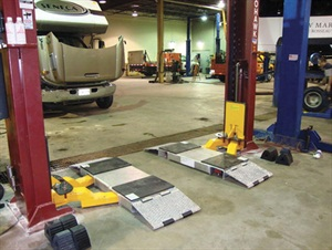 Speed ramps are easily added to a twin-post lift's arms. This can ease lift arm placement, often eliminating the need for a technician to get on his knees or back to place the lift pads.