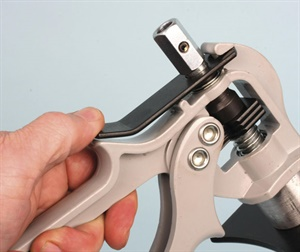 In order to retract the drive rod and remove the tool from the caliper, grasp the rear fixed handle only and depress the black retainer lever, then pull the 9/6-inch hex drive rearward.
