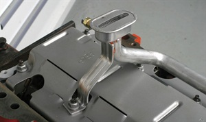 The pickup tube's screen end features a bracket that attaches to a stud tip at a main cap location. The nut should be a locking style.
