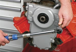 Torque the front cover bolts in a crisscross manner to spread the clamping load evenly. Tighten the 8 mm bolts to 18 ft.-lbs.