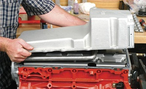 Before installing the oil pan gasket and the oil pan, apply a small bead of RTV along the exposed gasketed joint between the front cover and the block. Be sure to thoroughly clean the oil pan prior to mounting.