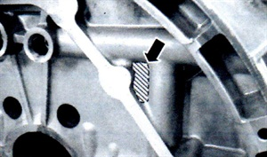 Note the arrow indicating the potential location of an oil leak due to casting porosity.