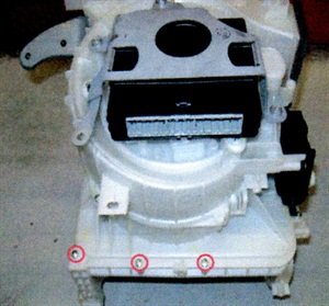 Remove the upper portion of the blower motor housing by removing the retaining screws.