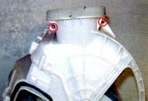 Separate the upper portion of the blower motor housing by removing the retaining screws and clip.