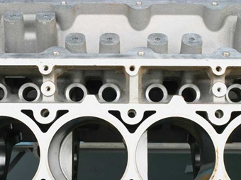 This view shows the lifter bores, immediately above the cylinders. The lifter bores are covered by the cylinder head.