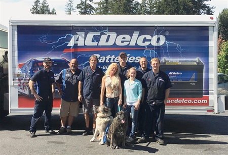 The Local Wrench staff, from left to right: Kyle Armstrong, Jeff Schaar, Jeff Baker, Dena Baker, David Lomax, Stormy Burnett, Brett Schaff and Patrick Bruemmer. The dogs, Deuce (left) and Lynzee (on the right), are the shop's celebrities who keep a sharp eye on operations.