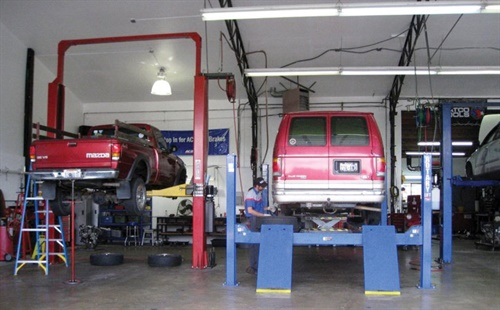 The service bay's front row features four lifts, including both twin and four-post lifts.