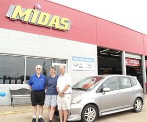 Wayne Earlston, Lori Duewell and Mike Pace celebrated Duewell's Honda's mileage milestone.