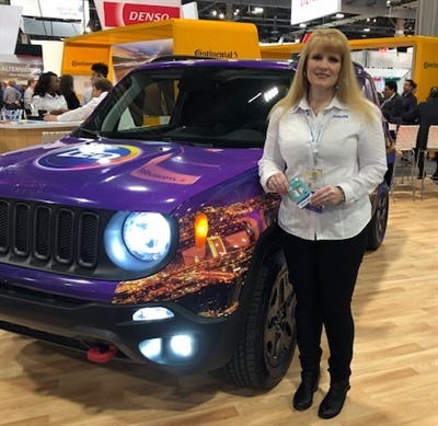 Dawn Gonzalez, marketing communications manager for Lumileds, is next to a vehicle retrofitted with Extreme Ultinon LED fog lamps and Ultinon LED lights.