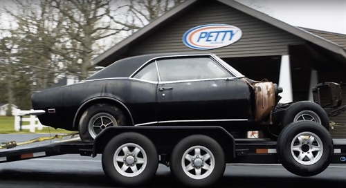 A scene from an early video in the series showing the 1968 Camaro arriving at Petty's Garage after being towed from a field in Martinsville, Va.