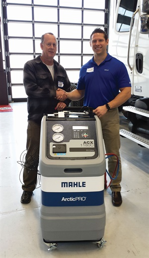 MACS member Bob Stockero (left), automotive instructor at Santa Barbara City College, accepts an an ArcticPro ACX1180C donated by Mahle Service Solutions for the college's tech program. Stockero is congratulated by Chuck Kinkade, business development manager for Mahle Service Solutions.