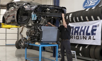 The initial step in the modification is the removal and disassembly of the 5.0-liter engine. All parts will be inspected and the engine will be reassembled with Mahle Original parts.