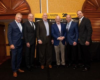 Maxon Lift executives accept the MVP Award from Dickinson Fleet Services.