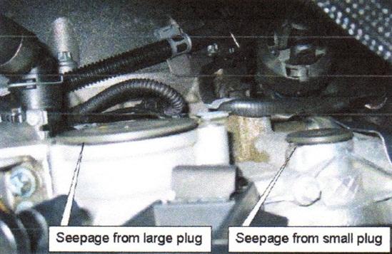 Large plug (left) and small plug on rear of cylinder head.