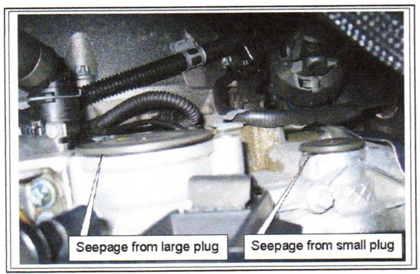 View of rear of cylinder head. Large plug (left) and small plug (right).
